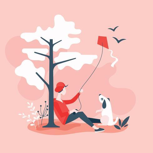 Hombre con mascota volando cometa en la colina por un árbol