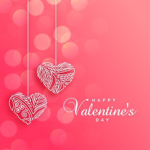 schöne dekorative Herzen auf rosa Bokeh-Hintergrund
