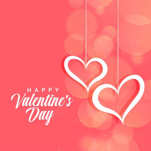 hängende Herzen auf rosa Bokeh-Hintergrund für Valentinstag
