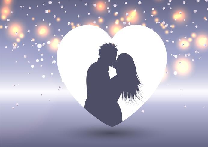 Silhouette di una coppia che si bacia in un cuore