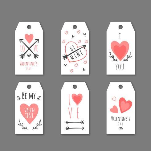 Gulliga Alla hjärtans etiketter med hjärtan, pilar och meddelanden.