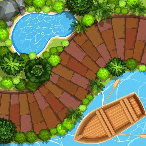Vista al parque con barco en el agua.