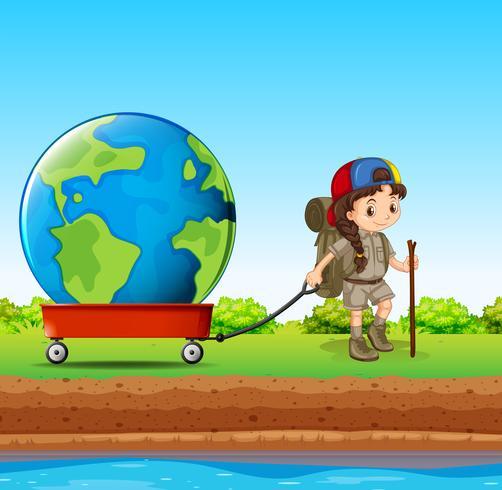 Meisje dat bol in rode wagen trekt