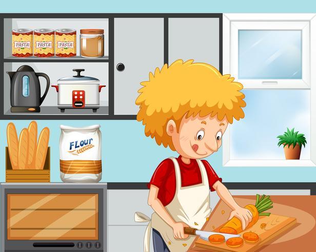 Jonge jongen die in de keuken kookt