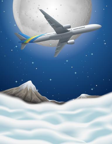 Vliegtuig die over de bergen vliegen