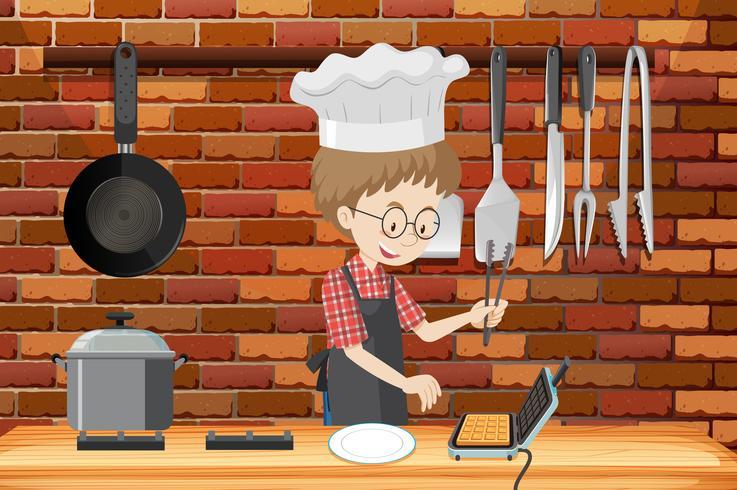 Un homme cuisinant des gaufres dans la cuisine