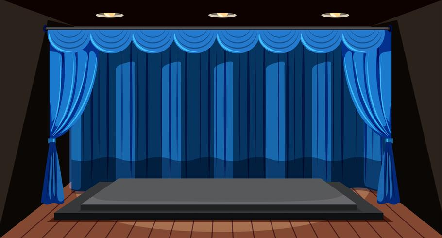 An empty stage with blue curtain