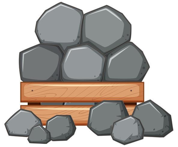 Stapel av sten i trälåda