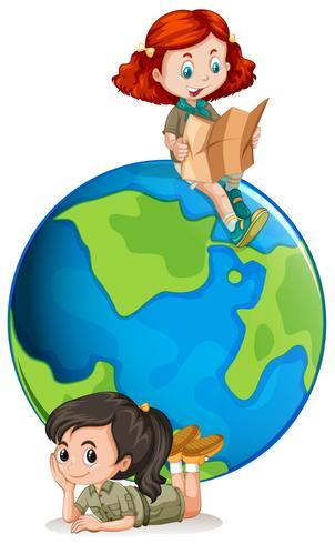 Jeune fille scouts devant un globe