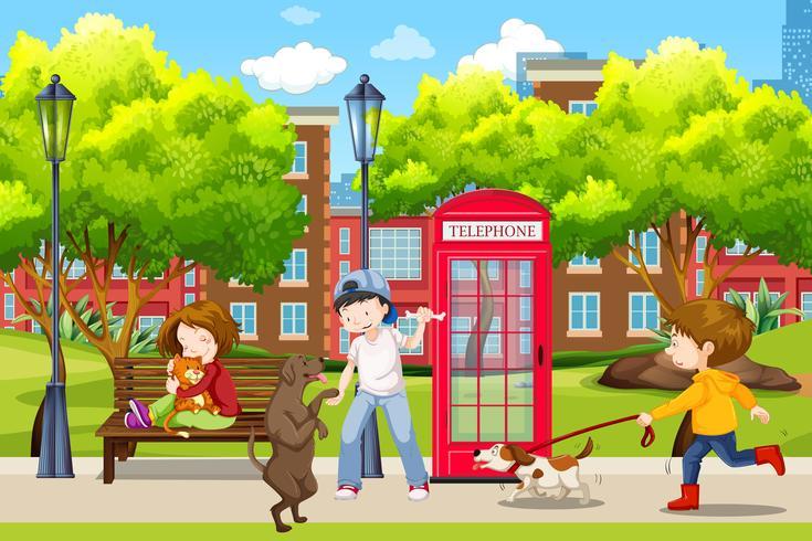 Menschen und ihre Haustiere im Park