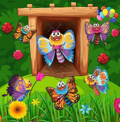 Bunte Schmetterlinge, die in Garten fliegen