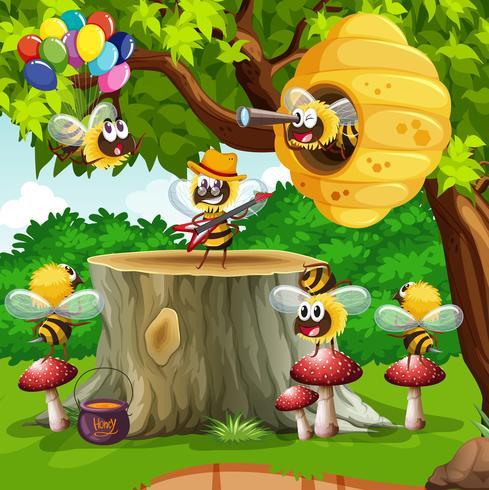 Abeilles et ruche sur l'arbre vecteur