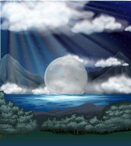 Escena con luna llena sobre el lago