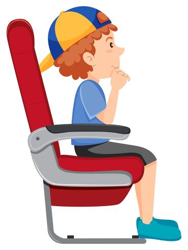 En pojke på flygplanssätet