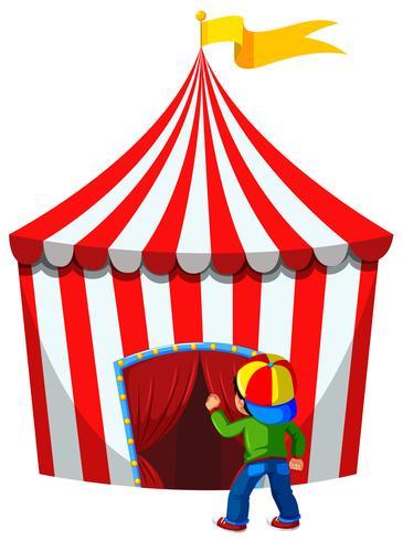Um garoto entra na tenda do circo vetor