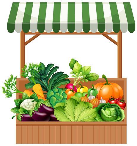 Grönsaker på trähylla