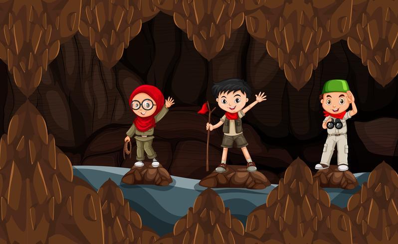 Esploratore che esplora la caverna oscura vettore