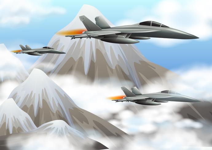 Tres aviones a reacción sobrevolando las montañas.