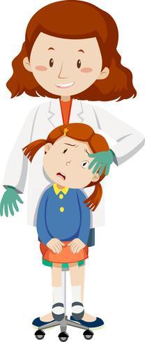 Arts die jong meisje met oogverwonding helpt