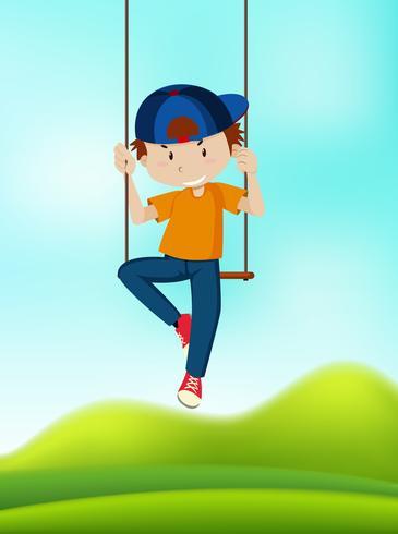 Un ragazzo che gioca sull'altalena