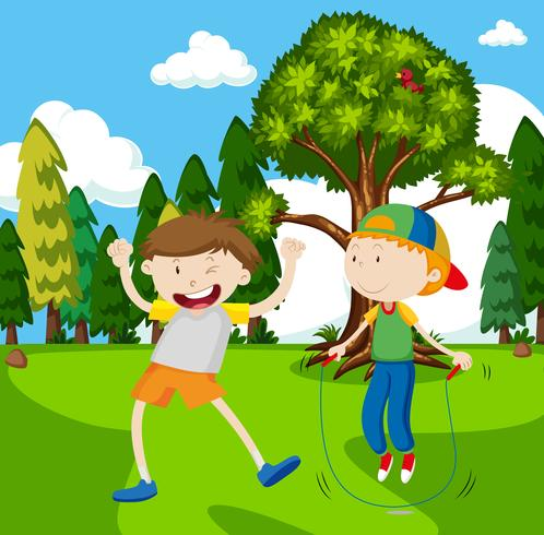 Twee jongens die jumprope in park spelen