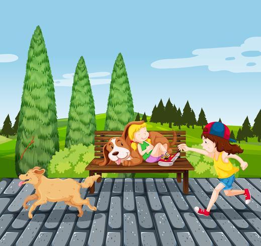 Enfants avec animal de compagnie dans le parc