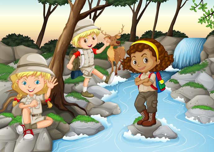 Children having fun at the waterfall vector