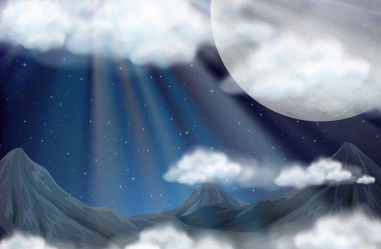Scena con luna piena e montagne