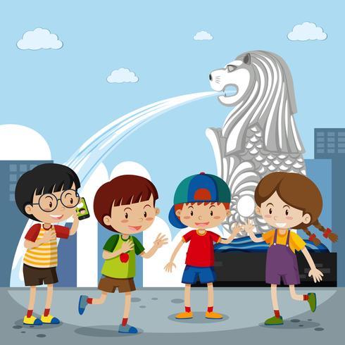 Quatro crianças no Merlion em Cingapura