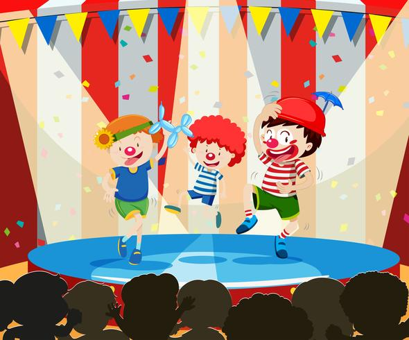 Three circus children performing