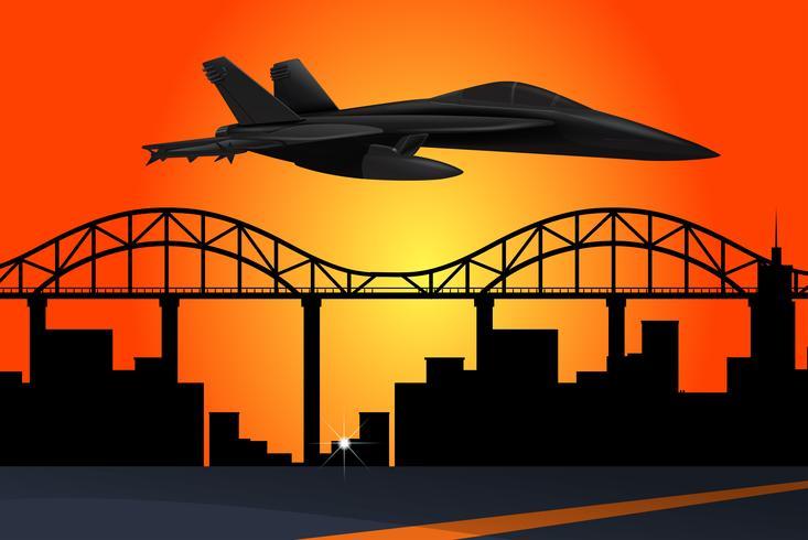 Jetplan flyger över staden vid solnedgången