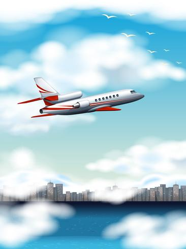 Szene mit dem Flugzeug, das über Stadt zur Tageszeit fliegt