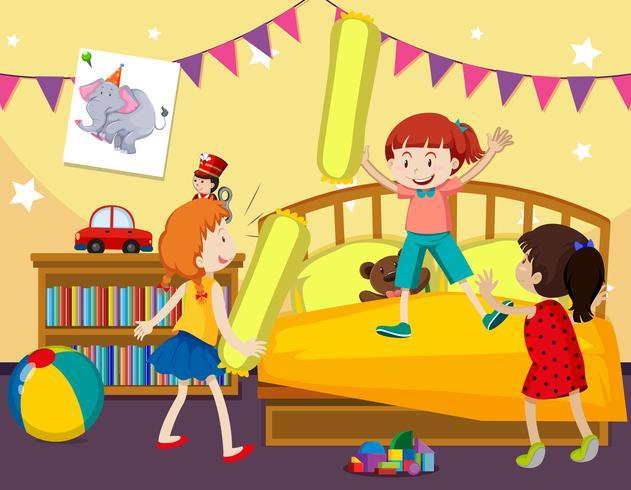 Children play pillow fight in bedroom