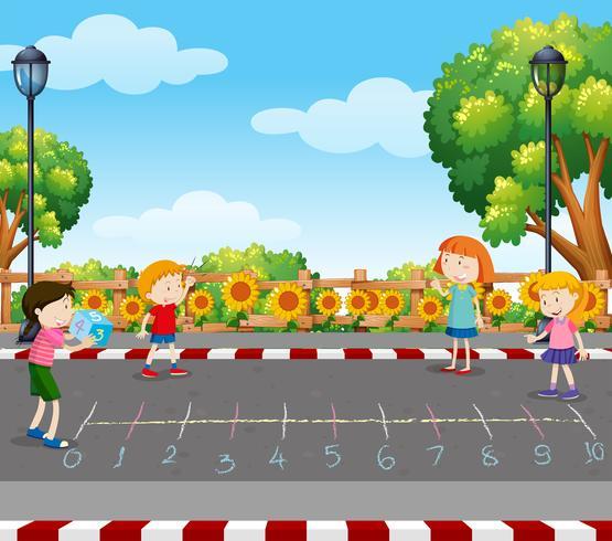 Kinder spielen Würfelspiel im Park