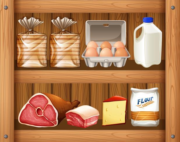 Diversi tipi di cibo sullo scaffale in legno