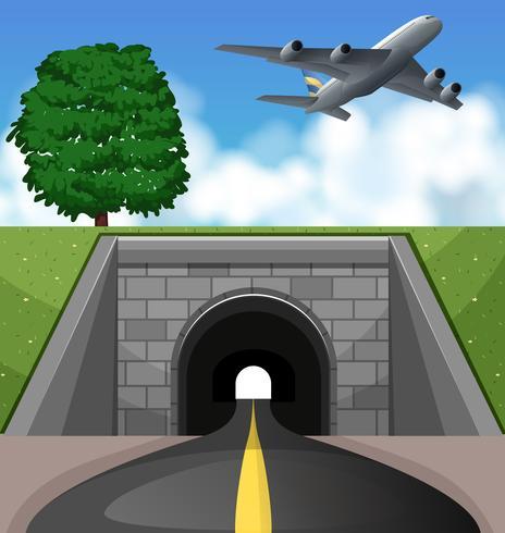 Flygplan som flyger över tunneln