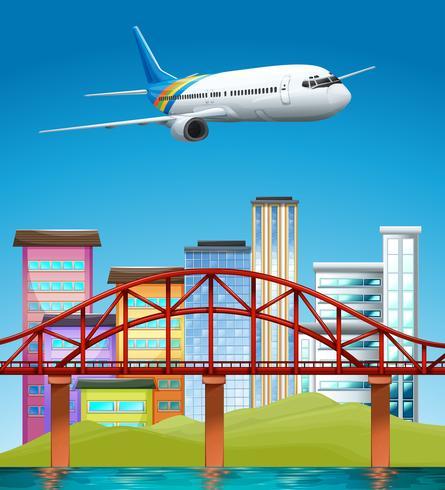 Flugzeug fliegt über Gebäude