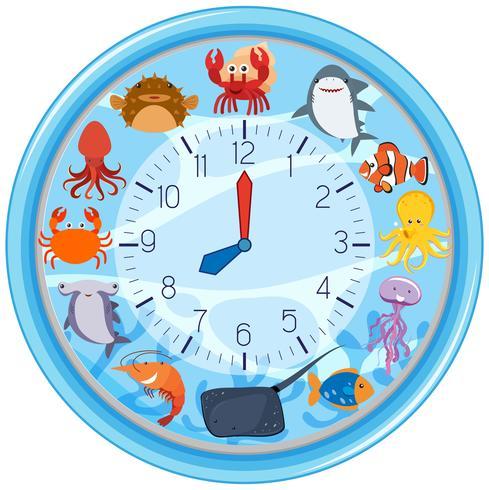 Un reloj con plantilla de criatura marina. vector