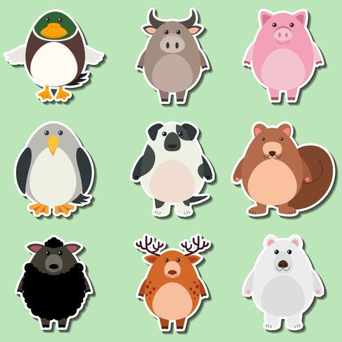 Aufkleberdesign für nette Tiere auf grünem Hintergrund