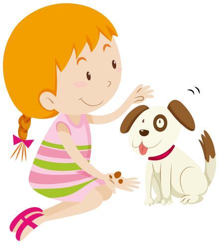 Nettes Mädchen, das ihren Schoßhund füttert