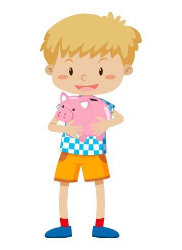 Ein Junge, der Sparschwein hält