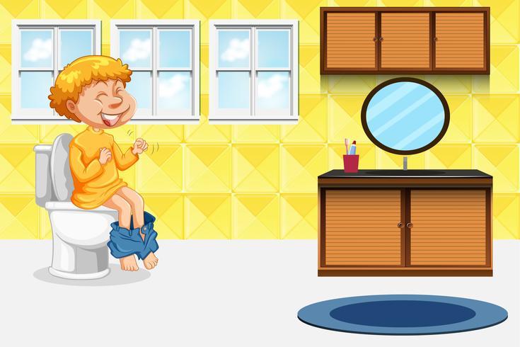 Junge, der die Toilette nimmt