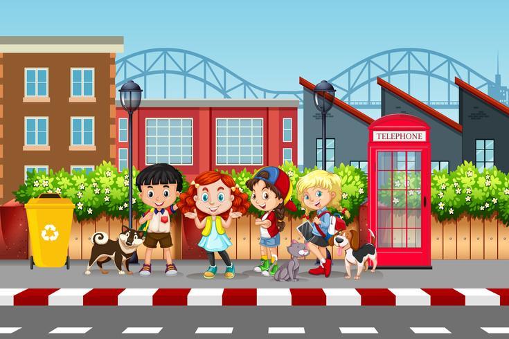 Escena callejera de niños y mascotas.