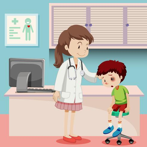 Doctor helping boy with bruise