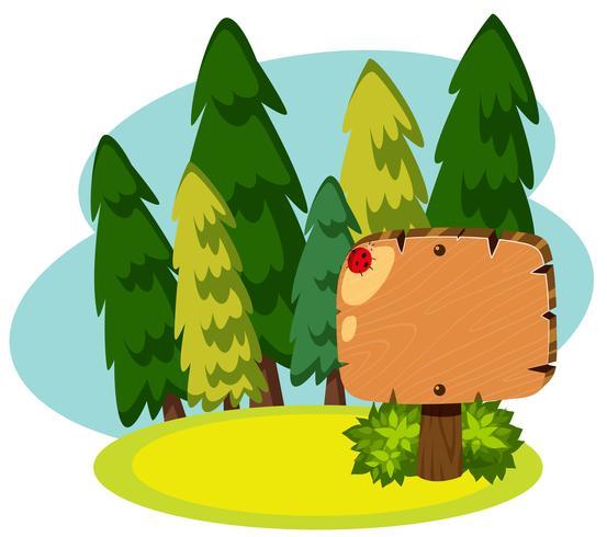 Hölzerne Fahne im grünen Wald