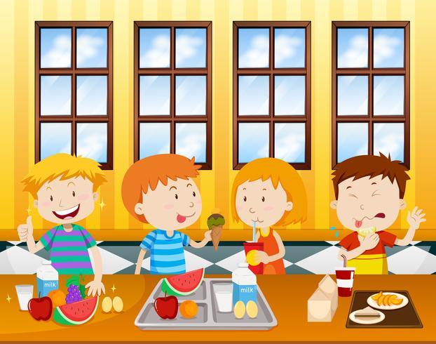 Niños comiendo en una cafetería.