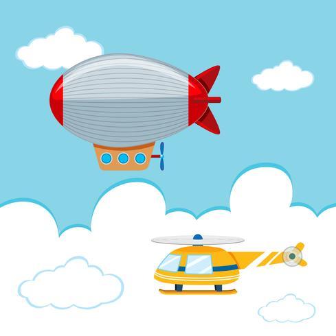 Luftschiff und Hubschrauber am Himmel