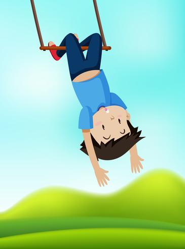 Un garçon sur balançoire