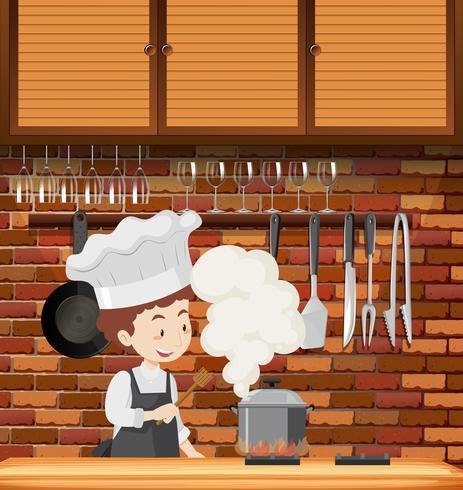 Un chef cuisine en cuisine vecteur