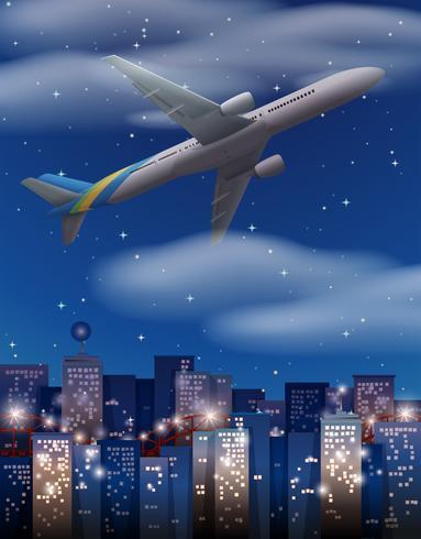 Flygplan som flyger över byggnader i staden